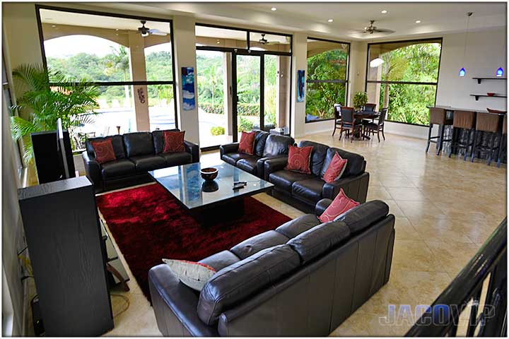 Three large sofas in living room