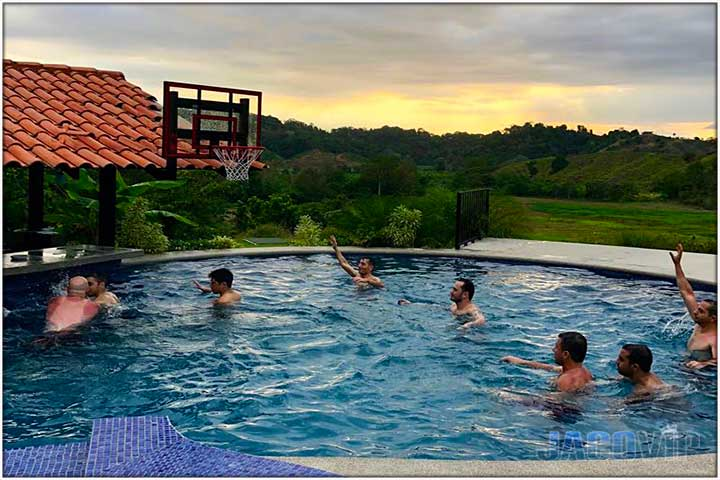 Guests playing swimming poll basketball